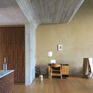 Curved concrete walls snake through Berlin artist's residence by Philipp von Matt