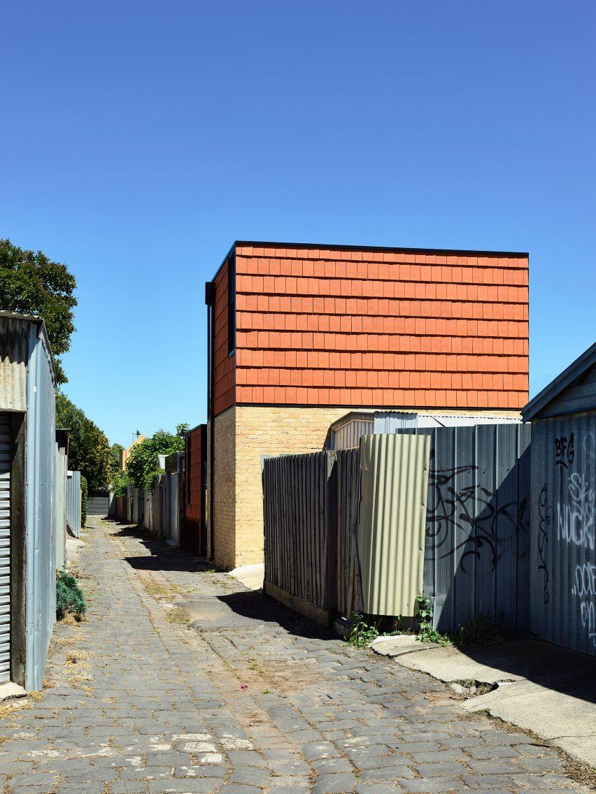 terracotta house is clad in terracotta tiles