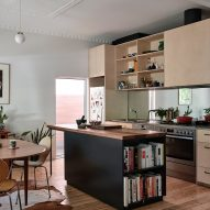 The kitchen in the existing home has a wood design