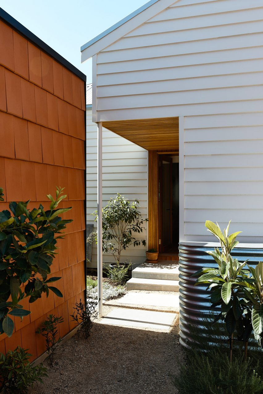 The existing home has a white panelled design