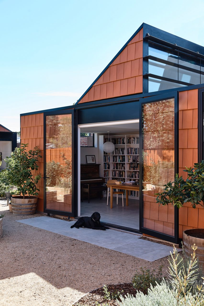 Black trim lines windows and doors at terracotta house