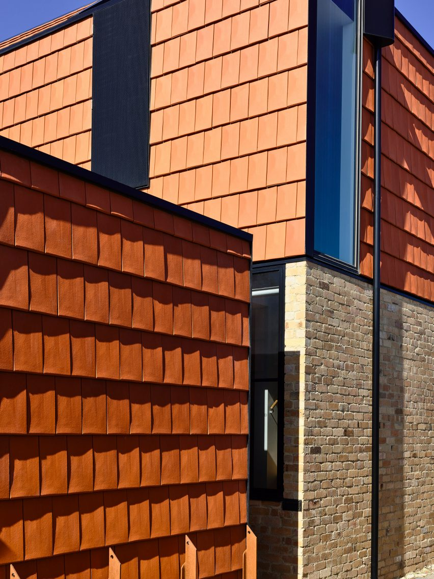 Recycled brick clads the exterior of terracotta house