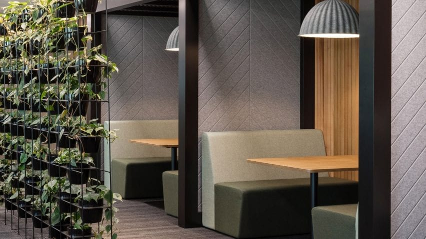 A seating booth with grey Autex acoustic panels
