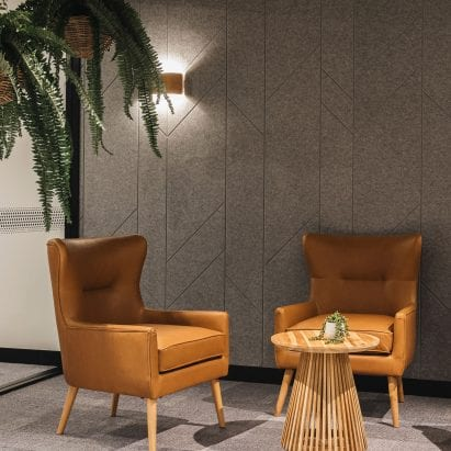 Two armchairs in front of Autex Acoustics panels