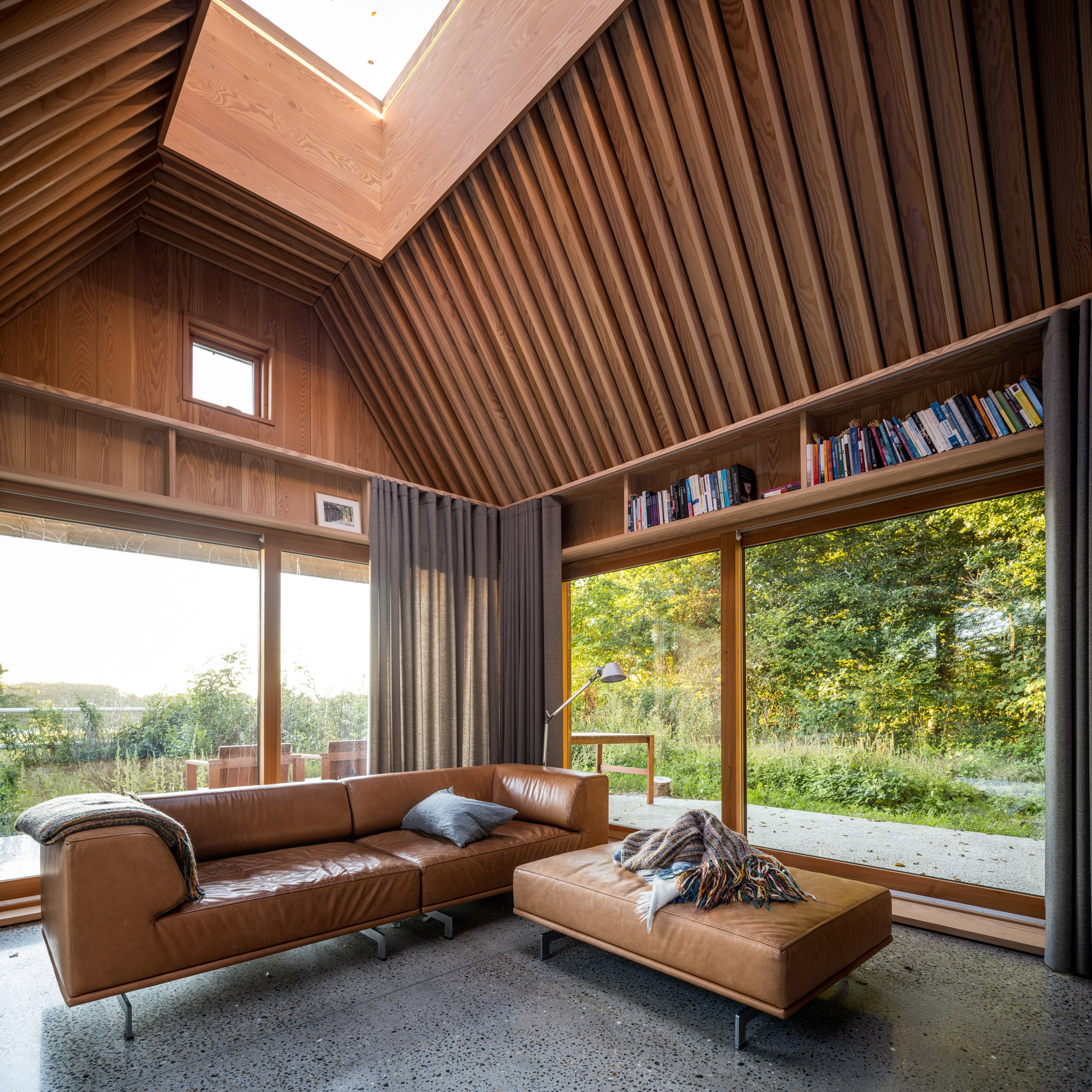 Sofa and in-built shelving in The Author's House by Sleth
