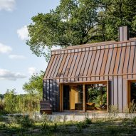 The Author's House is a copper-clad cabin in a Danish forest