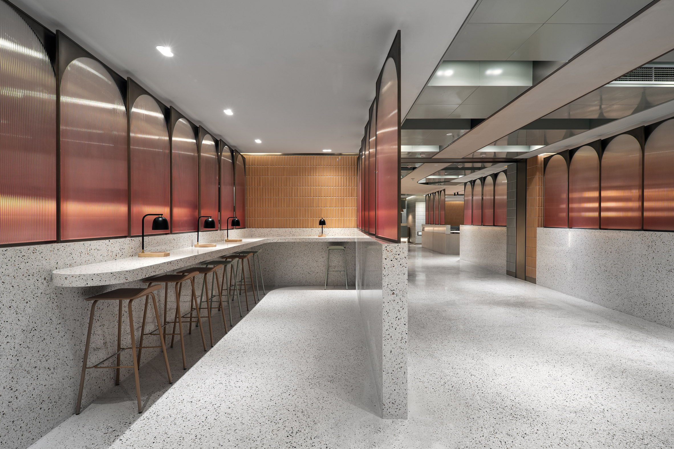 Canteen by SHH with terrazzo counter seating, terracotta tiles and ombre glass