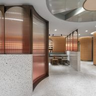 Arched glass panels suggest windows in basement canteen by SHH