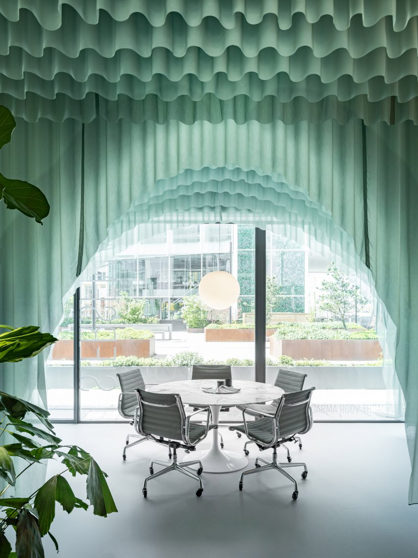 Tables are framed by arched fabrics