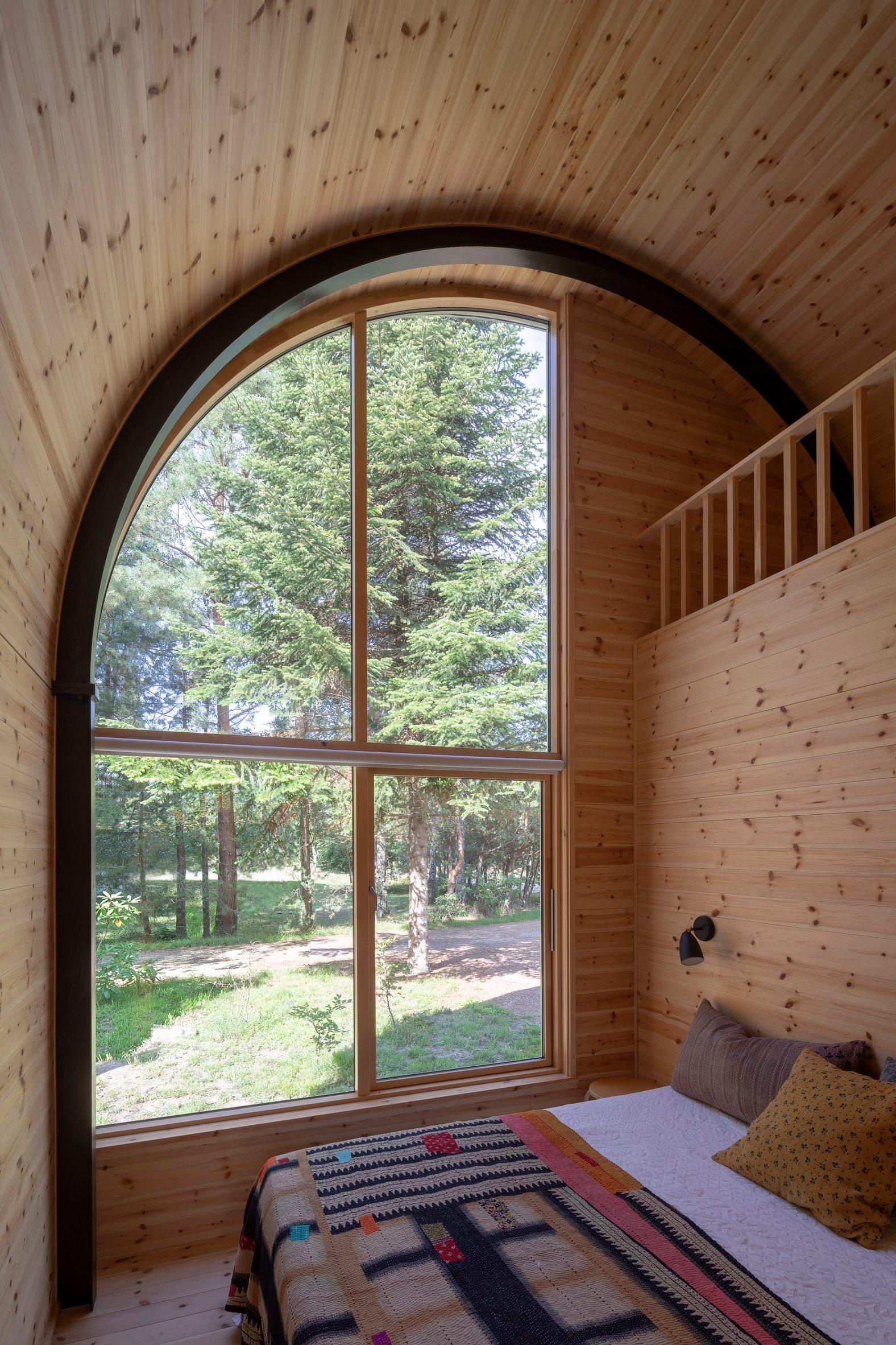 Barrel vaulted room by Valbæk Brørup Architects
