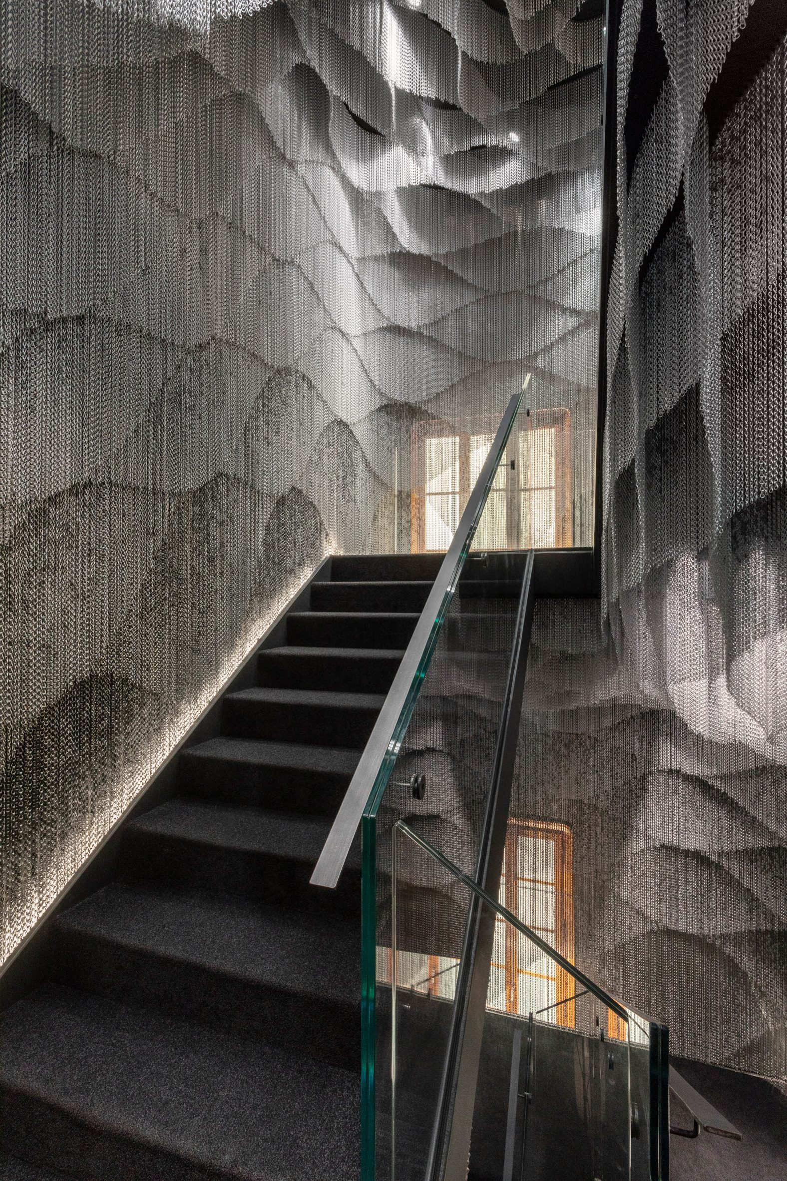 A staircase surrounded by metal-mesh