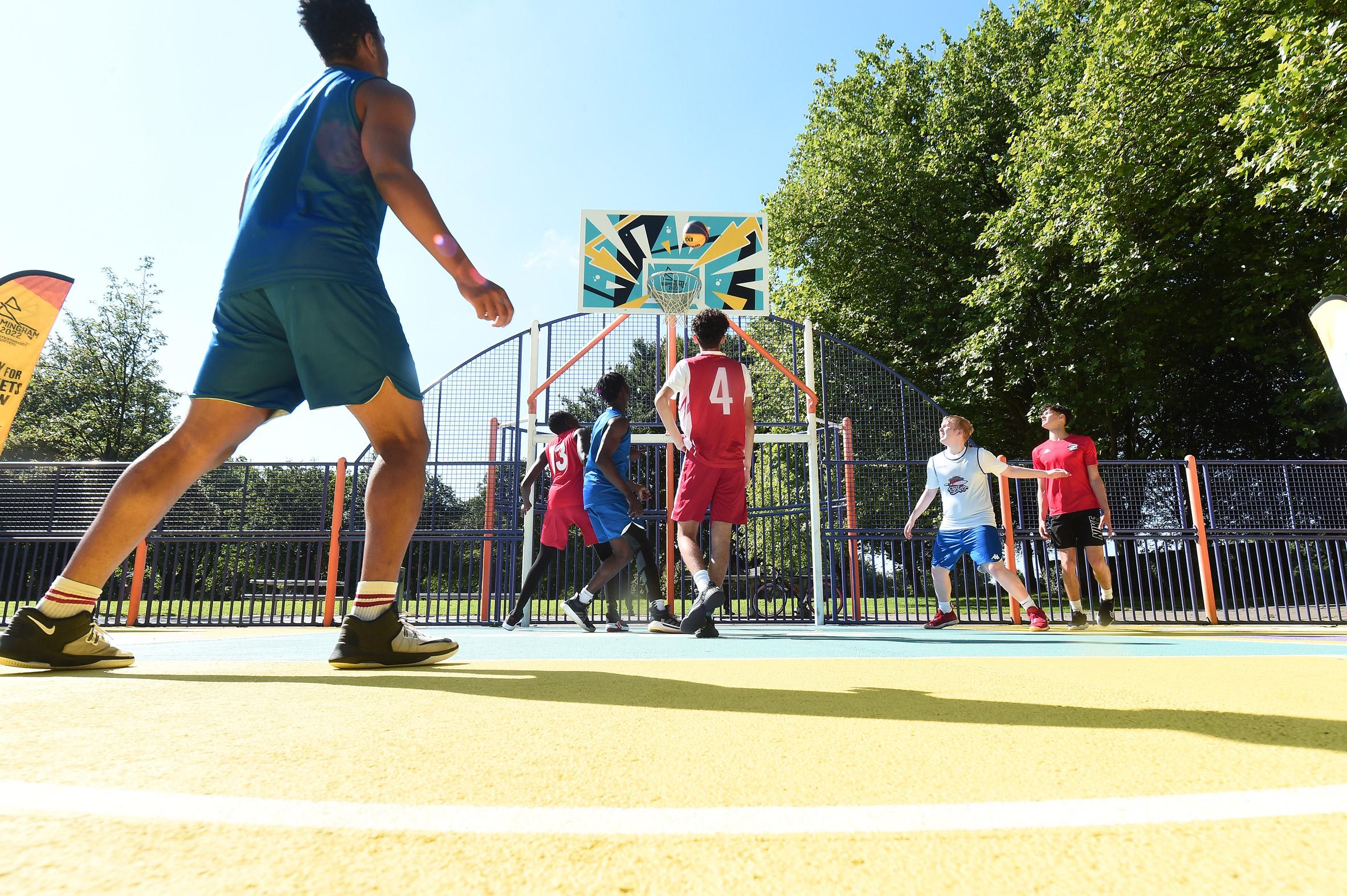 Players play a basketball match in Summerfield Park court