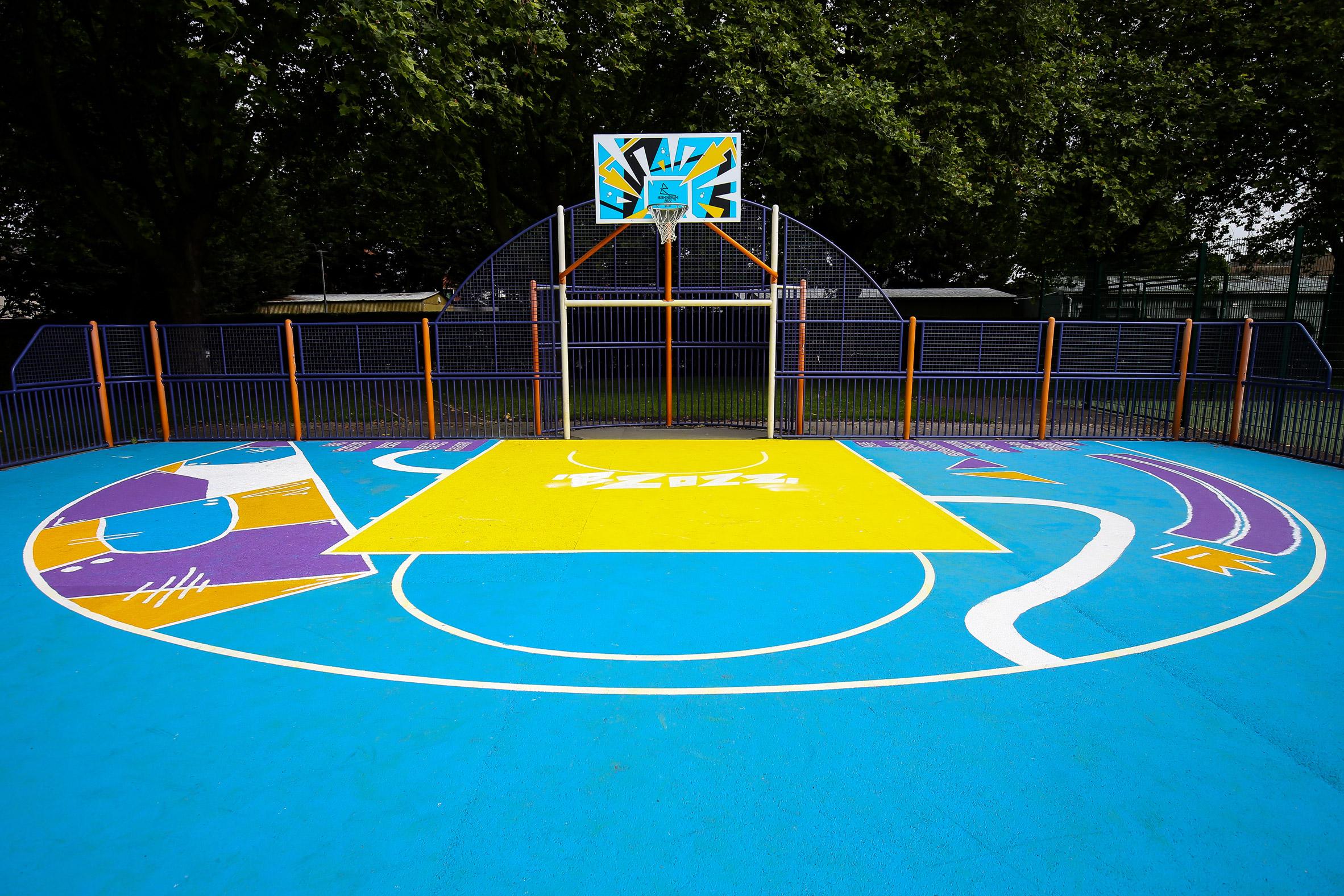 A concrete basketball court painted blue