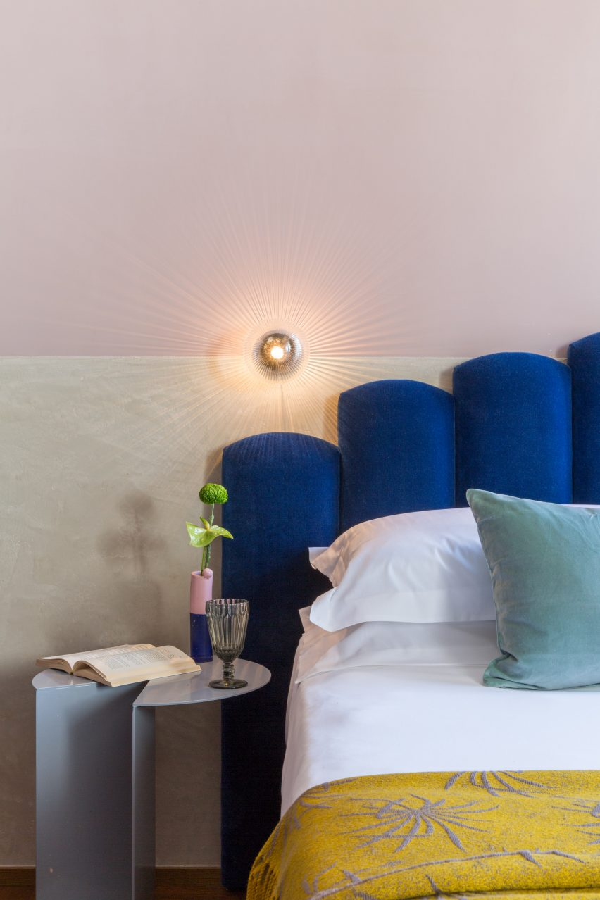 Chunky scalloped headboards in an Italian boutique hotel