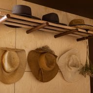 hats are placed on pegs