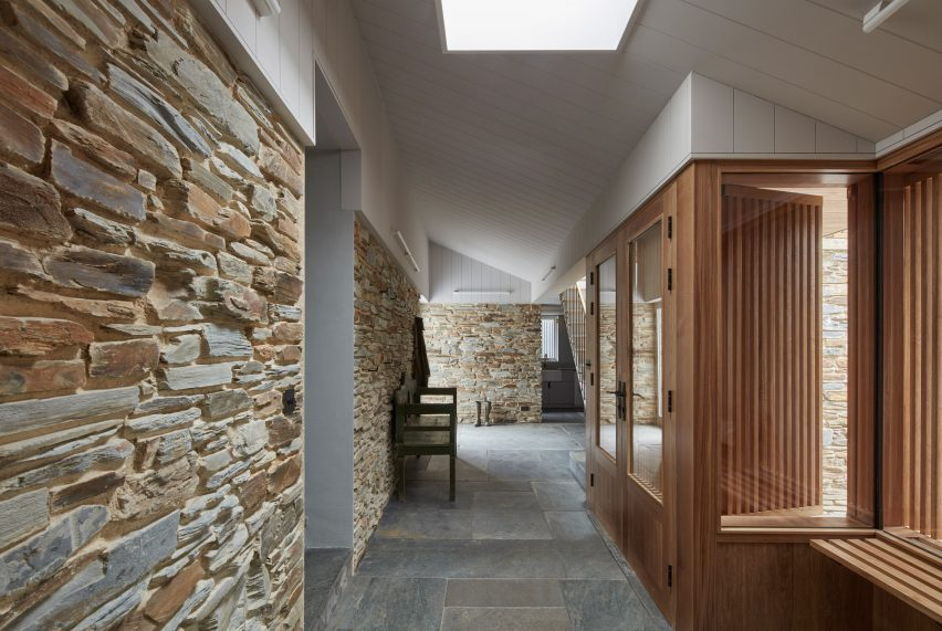 A hallway with a stone wall
