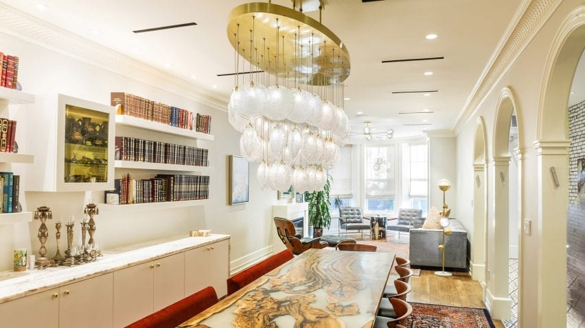 Crystal shell pendant lights hanging above a dining table