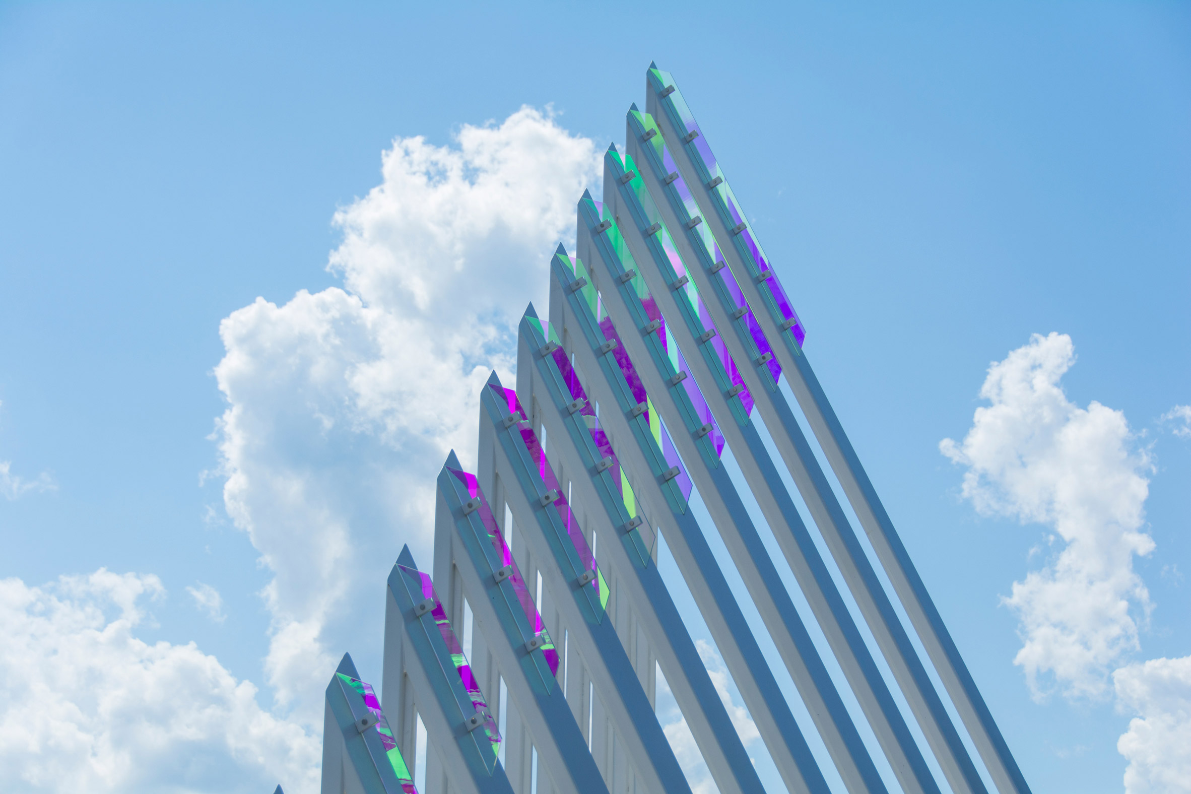 Glass fins refract colourful light during the day