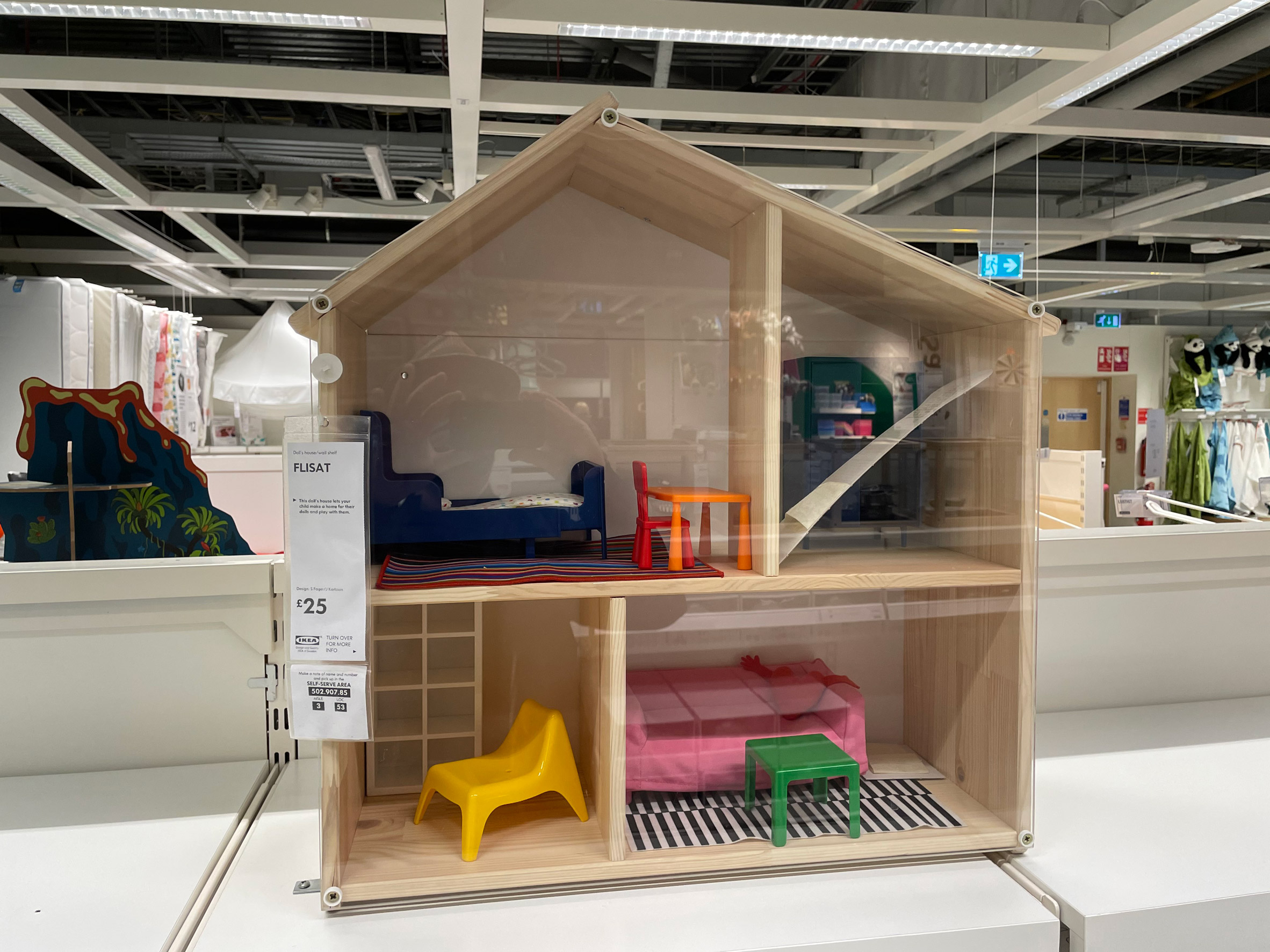 A wooden playhouse by IKEA