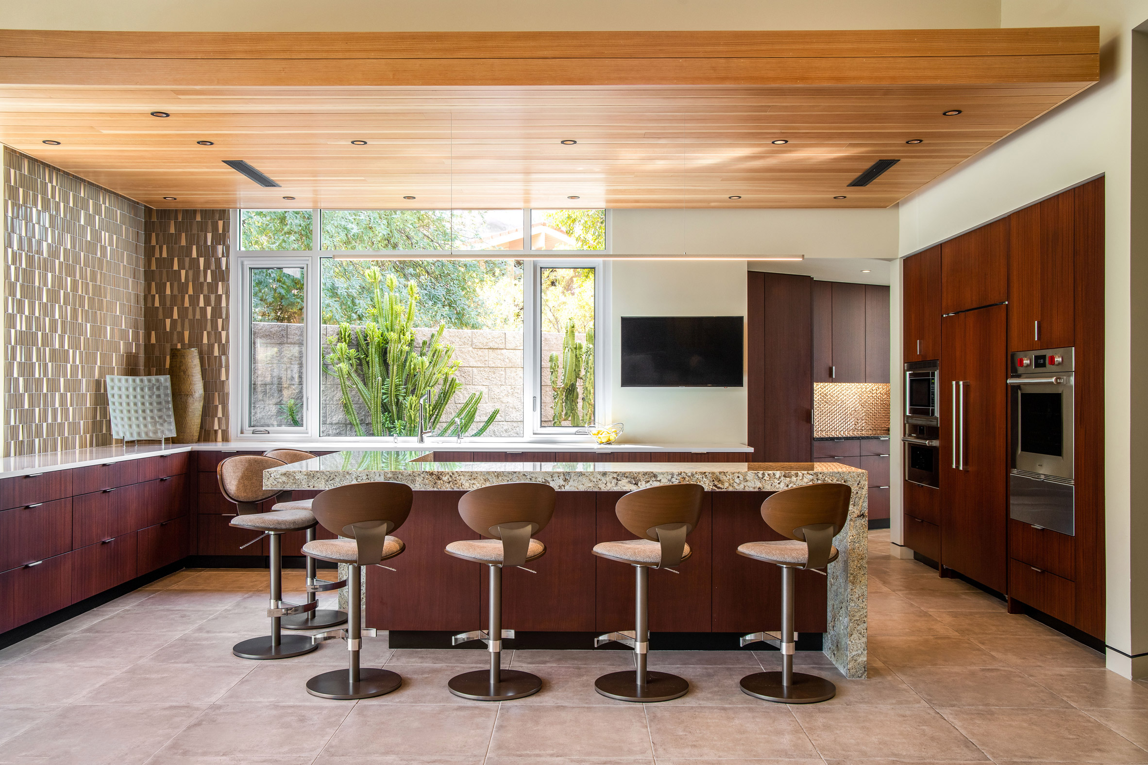 An earthy palette was used for the decor including the kitchen