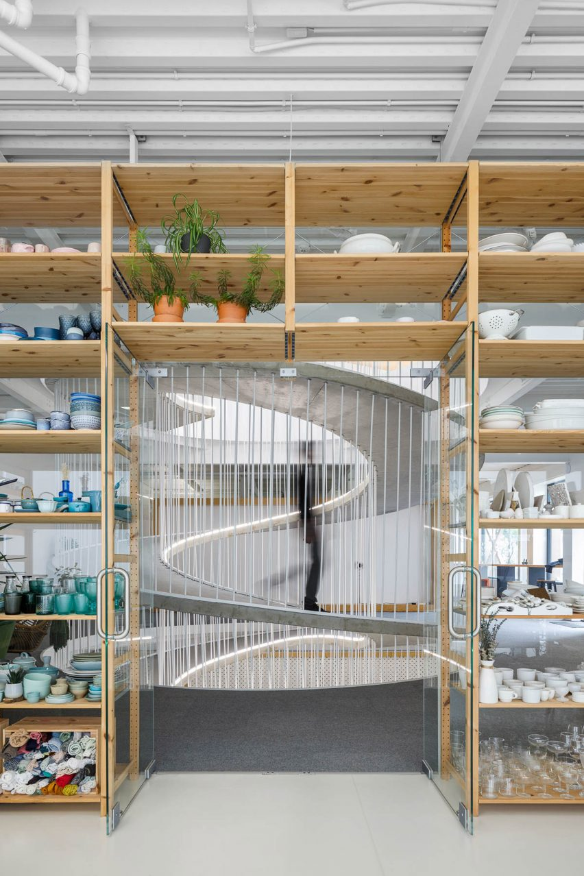 Doorway in storage wall filled with colourful ceramics in E-goi and Clavel's Kitchen by Paulo Merlini Architects