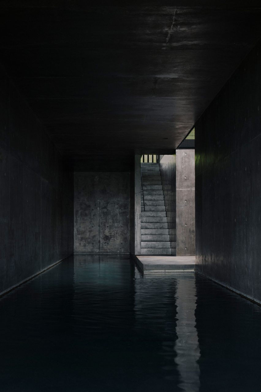 A swimming pool lined with black concrete
