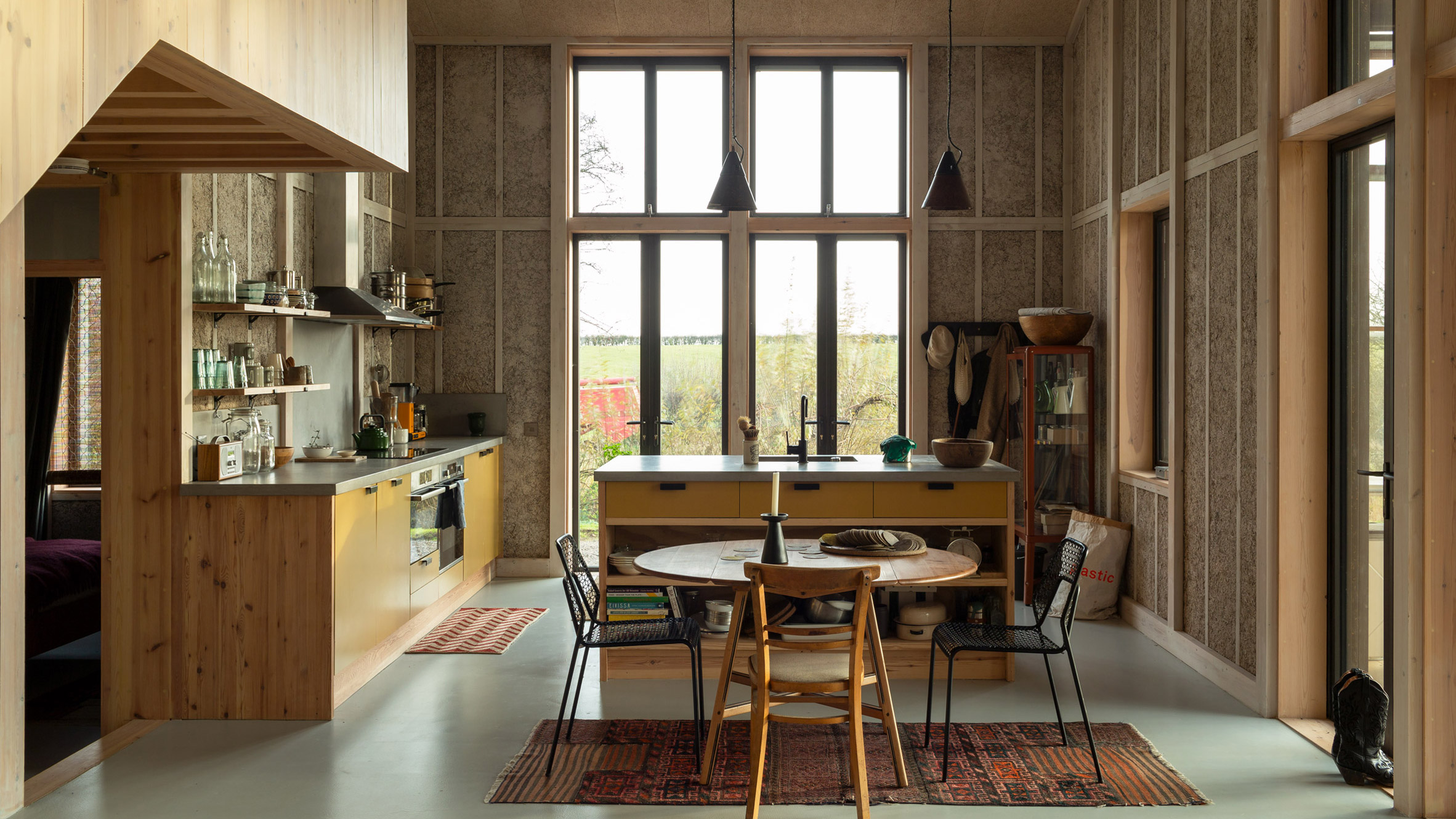 A domestic kitchen with exposed hempcrete walls