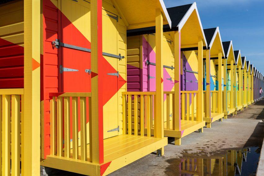 Yellow beach huts with colourful triangles by Rana Begum at Folkestone Triennial 2021