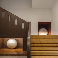 Mustard yellow tiles clad the walls of this Chengdu hotel by Archetype