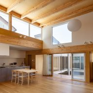 Living room with exposed wood ceiling