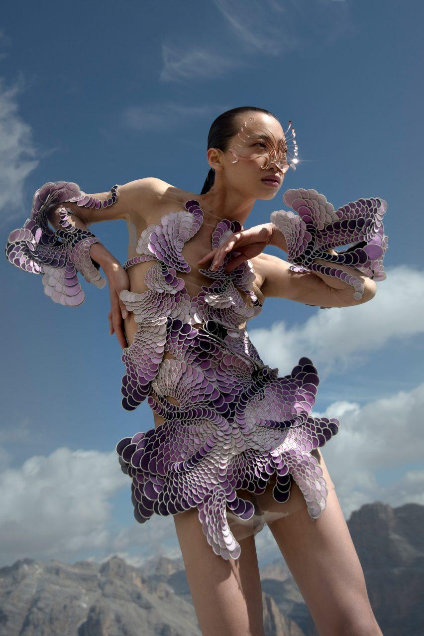 A woman wearing a purple dress from Earthrise