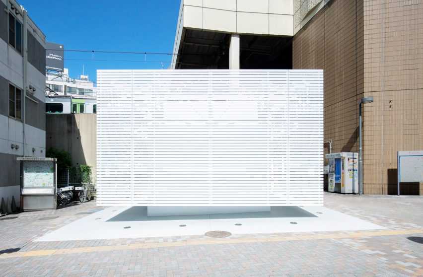 Toilet block wrapped in white louvres