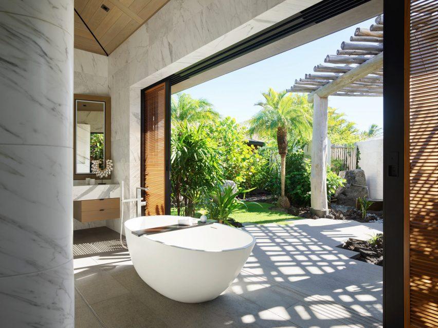 Marble clads the bathroom designed by de Reus Architects
