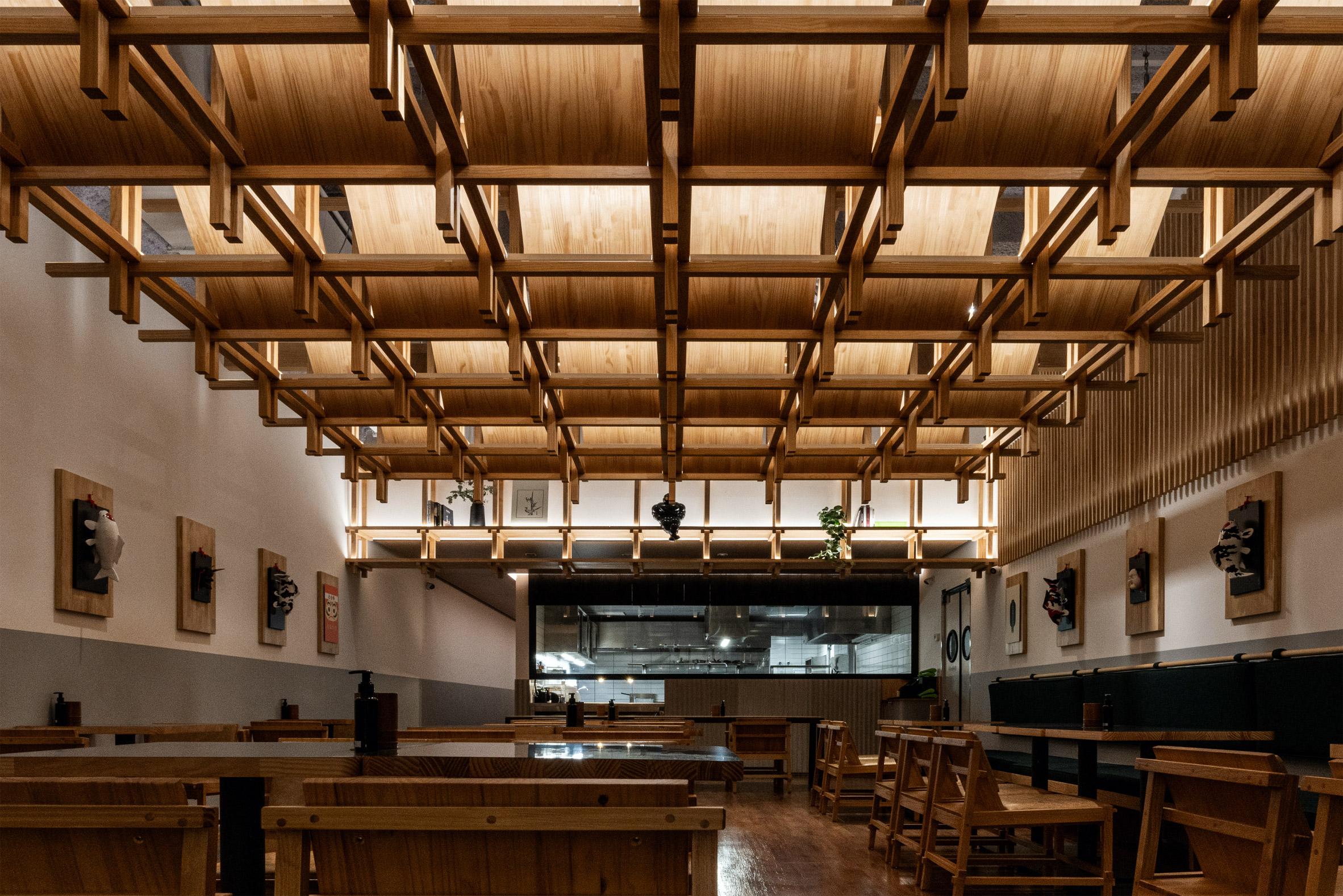 Restaurant interior design in São Paulo with wooden canopy