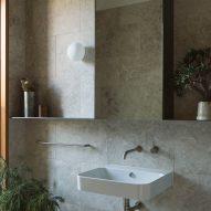 A bathroom with stone tiles