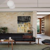 A living room with exposed brick walls