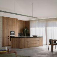 An open-plan kitchen with wooden cabinetry