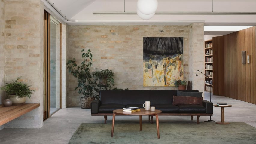 A living room with brick walls and pitched ceilings