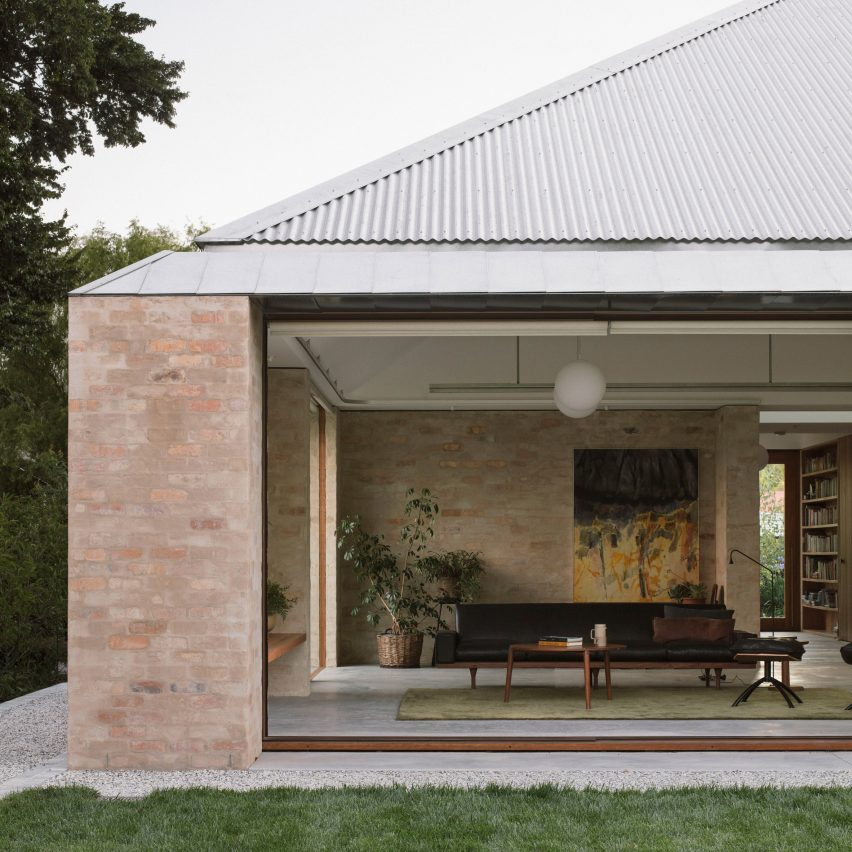 A brick house with a corrugated metal roof