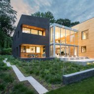 Studio PHH divides lakeside house with double-height glass atrium