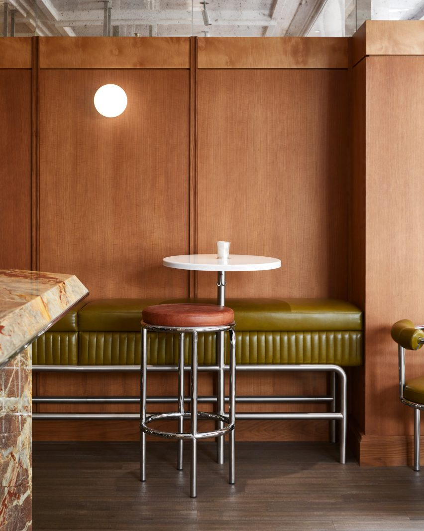 Wood panelling and green leather bench in Abstinence restaurant