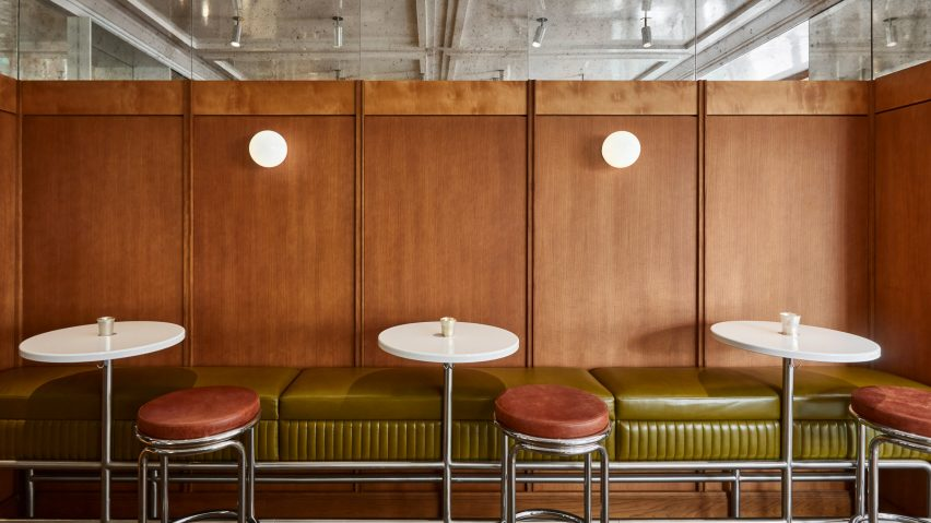 Wood panelling with green leather bench and stool Abstinence