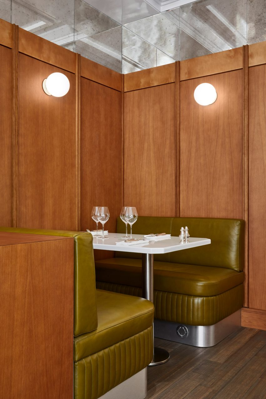 Wood panelling with leather booth and spherical lights in restaurant interior by Lizée-Hugot
