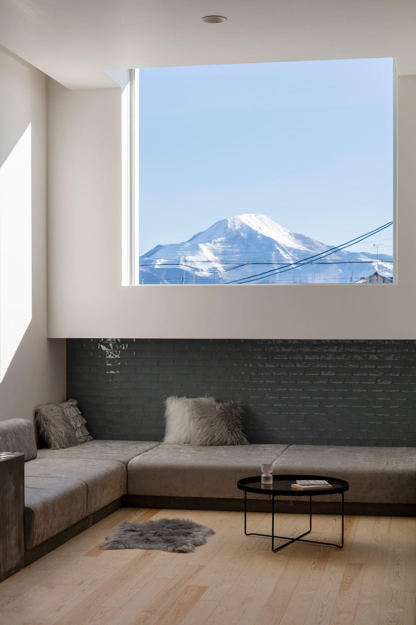 A living room overlooking Mount Ikubi