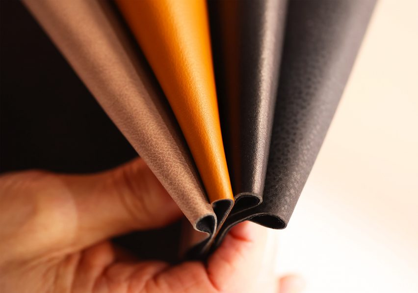 Hand holding swatches of different coloured apple leather by Beyond Leather