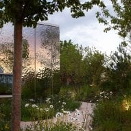 Mirrored cladding reflects gardens surrounding Maggie's Southampton by Amanda Levete