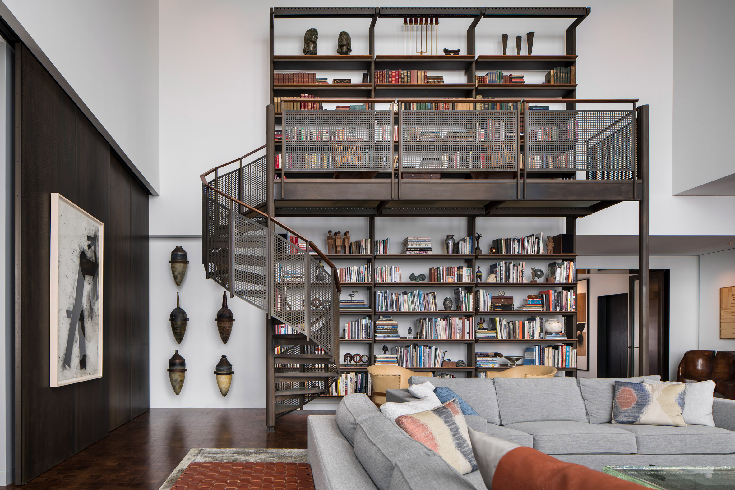 Bookcase mezzanine by Wheeler Kearns Architects