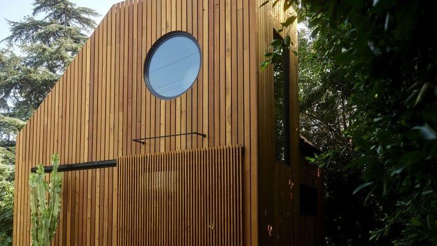 Monon Guesthouse's sliding door and circular window