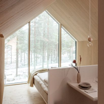 Wood lined cabin bedroom
