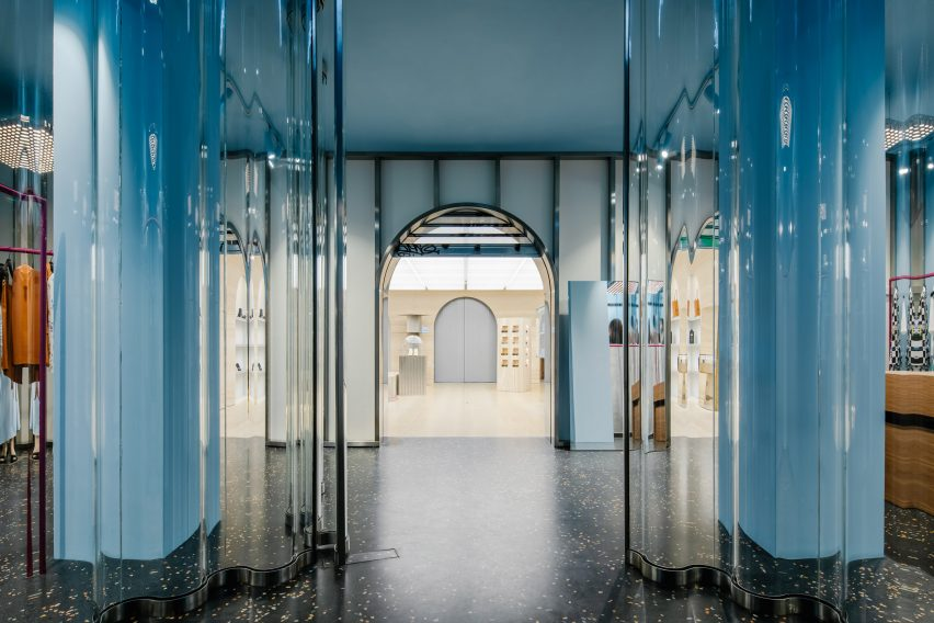 Blue pillars behind clear acrylic curtains in Off-White Paris store